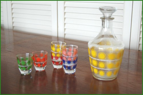 french decanter and shot glasses