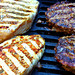 Chicken Breasts and Hamburgers on the BBQ Grill by Scandblue