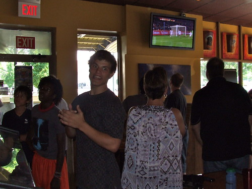 Local soccer fans celebrate the U.S. win over Algeria at the Asheville Pizza Company