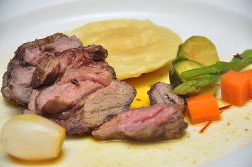 Slow Cooked Rump of Lamb Parsnip Ravioli Saffron Poached Vegetable Jus