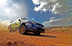 RALLY MAGIC -  IMG_4335 ed+cr (greekadman) Tags: blue sky cars clouds speed photoshop greek rally greece wrc u subaru gravel acropolisrally canon30d tokina1224f4 supershot flickrsbest thiva imprezasti shieldofexcellence anawesomeshot diamondclassphotographer flickrdiamond ysplix acropolisrally2007