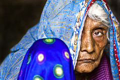 Life.... (Divs Sejpal) Tags: life old blue portrait people woman india color colour eye colors face closeup lady asia colours veil indian details clothes age elder saree wrinkles gujarat ahmedabad divs divyesh intrestingness flickrexplore explored sejpal
