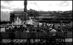 The bench lovers series #4. (flevia) Tags: shadow bw bench relax sweden stockholm bn riposo siesta tribute sverige scandinavia stoccolma biancoenero kulturhuset nikonfa panchina hotorget v700 scannednegatives sigma24mmf28 bnscorci epsonperfectionv700photo flevia thebenchlovers elviramujcic swedishlovetositinbenches fomapan400actionpushedto800fomapan