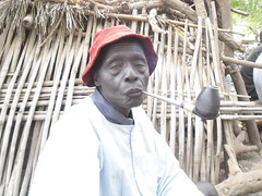 Tobacco market-Rumbek Southern Sudan,Africa (magicgate) Tags: africa portrait man market smoke sudan rumbek pipe southern tobacco dinka