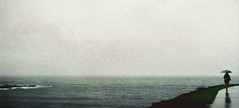 Transatlanticism (Xiangk) Tags: ocean sea film beach rain umbrella 35mm minolta sydney rainy coogee