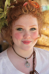 Radiant Red (wyojones) Tags: texas toddmission texasrenaissancefestival feathers fest festival freckles redhead renaissance girl blueeyes smile teeth pretty cute lovely beautiful wench servingwench server foodservice eyes flowers hair damsel maiden women young lady kettle corn bags younglady kettlecorn woman wyojones faire renaissancefestival renaissancefaire renfest trf renfaire rennie cassie
