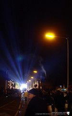 Blue meets orange (thinctanc) Tags: 2003 street carnival light orange lamp lights glow post bright crowd glastonbury laser streams beams