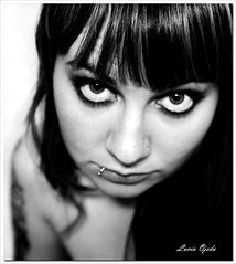 Alfileres en la mirada (Mi matadero clandestino) Tags: portrait people bw woman white selfportrait black blanco me girl beauty face up tattoo person mujer eyes pretty chica close gente emotion yo negro evil lips ojos lucia piercings autorretrato emotions mirada rostro sarcasmo shhh corporal tatuaje autofoto expresion lenguaje sentimientos ironia ojeda
