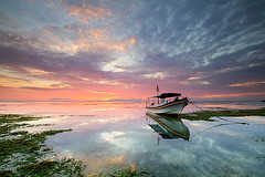 Sunrise over Sanur Lagoon, Bali (Explored) (Nolan Caldwell) Tags: bali cloud sunrise canon reflections indonesia coast boat lagoon sanur leefilter eos7d