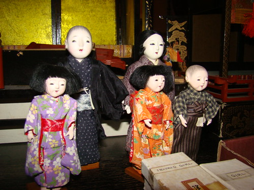the family that arrived with the dollhouse