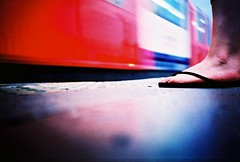 waiting at east acton (lomokev) Tags: red motion blur london feet sarah train underground subway shoe movement lomo lca xpro lomography crossprocessed xprocess shoes dof metro low transport tube platform ground lomolca motionblur thongs flipflops vehicle londonunderground agfa jessops100asaslidefilm agfaprecisa gels acton pugh lomograph fiance agfaprecisa100 cruzando sarahp spuw fianc eastacton precisa ratseyeview jessopsslidefilm rockcakes rockcake flickr:user=rockcake flickr:nsid=52261030n00 file:name=070704lomolcaplus18 rota:type=mabye roll:name=070704lomolcaplus
