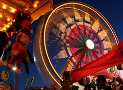 Carnival Night (A Sutanto) Tags: california ca longexposure carnival blue usa wheel night america toys lights monkey evening twilight dusk spiderman fair ferris games tent curiousgeorge ferriswheel prize bluehour countyfair sanmateo yello supershot abigfave superaplus aplusphoto