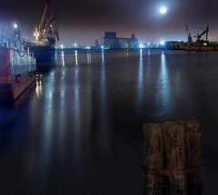 Harbor Mist (Rick Elkins) Tags: newyorkcity moon mist newyork water brooklyn night docks reflections lights harbor bravo searchthebest ships pilings redhook soe eriebasin mywinners abigfave colorphotoaward superaplus aplusphoto superbmasterpiece goldenphotographer diamondclassphotographer thegoldenmermaid rickelkins