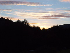 BLACK N' BLUE. (the water watcher 05.) Tags: blue trees light shadow mountain black tree nature silhouette clouds sunrise dawn scotland highlands bluesky glencoe lightandshadow daybreak yallow helios scottishhighlands highlandmountain kodakeasysharev803zoom