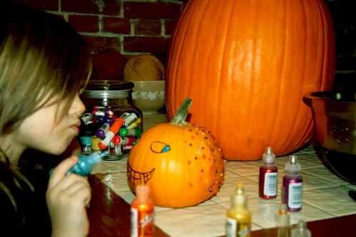 Eliza Painting her Pumpkin