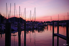 Back in harbor (norjam8) Tags: sunset red orange lake reflection water yellow harbor pier boat dock purple yacht michigan pb sail fp e14 blueribbonwinner lakemacatawa abigfave colorphotoaward superaplus aplusphoto diamondclassphotographer flickrdiamond imgp9823p norjamss