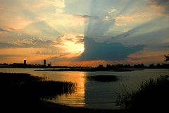 Yin Yang Sunset. (BamaWester) Tags: sunset sky lake reflection water clouds alabama decatur sunrays bamawester napg
