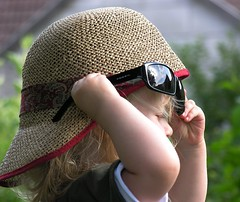 Little thieving magpie (:Linda:) Tags: germany thuringia village brden people child hat written sunglasses reflection sky two hand toddler cap granddaughter girl sarah leute menschen kind mdchen kopfbedeckung reflexion face