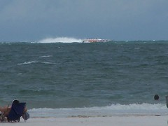 cigarette boat out in the Gulf (kthypryn) Tags: beach gulfofmexico water sand florida clearwaterbeach suncoast