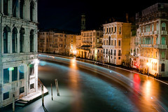 Gondola In 60 Seconds, Venice (flatworldsedge) Tags: city longexposure bridge venice italy rain night reflections lights canal wake italia shadows turquoise grand ponte trail gondola venezia notripod rialto vaporetto bathmat explored yahoo:yourpictures=wonders