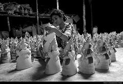 final touches (akshath) Tags: light shadow india white black lady canon town ganesha women shoot weekend bangalore stock documentary best clean buy pottery portfolio karnataka wipe bws photoshelter akshath akshathkumarshetty bws08sep07ganesha bpcexhibition