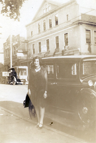 A young woman and a car