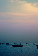 Boats by the sea (BALUCHI) Tags: light sea sun set night clouds boats bahrain nikon d100 malkiya supershot impressedbeauty aplusphoto