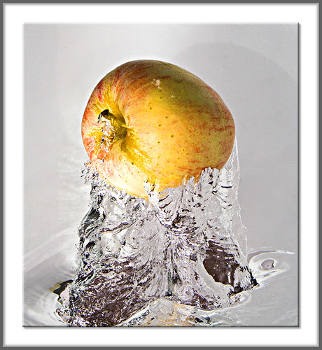 Apple Jumping Out Of The Water