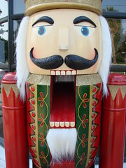 Nutcracker! Read All About It! (mckenzieo) Tags: ballet fantasy wintersolstice childrens crown cracker lifesize whimsical redcoat woodentoy gardenstreet goodneighbor pensacolafl nutcrackerking purplehairedchick trinintycollection diychristmascard 700wgarden fictitiouscharacter forbignuts