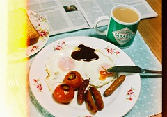 cath kidston breakfast (bobby stokes) Tags: summer food slr film japan breakfast japanese tea toast tomatoes meat lightleak pork nagoya sausages tabasco analogue fryup fullenglishbreakfast theguardian hpsauce  friedeggs cathkidston fullenglish