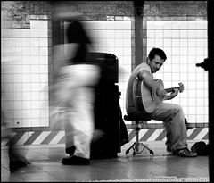 Forgotten Guitar Player (toddwshaffer) Tags: street nyc newyorkcity trash subway square movement metro guitar union can player singer stool performer guitarist strumming picker 10faves 25faves infinestyle bwartaward toddshaffer