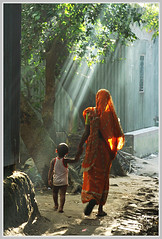 In Blissful Heaven [..Narayanganj, Bangladesh..] (Catch the dream) Tags: sunlight rural ray peace afternoon village child streak walk bongo mother rays foilage bengal bangladesh bangla bengali bangladeshi bangali narayangonj aplusphoto flickrelite catchthedream gettyimagesbangladeshq2