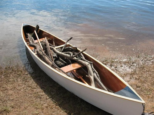 Plywood Quick canoe with load of firewood.