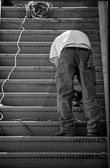 work ((matt)) Tags: light shadow blackandwhite man male vertical metal stairs keys daylight day pants worker grinder powercord grinding sanding powertool sander handtool