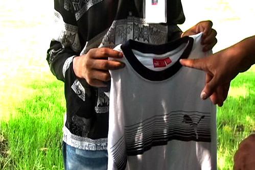 Mahmoud holds a PUMA shirt