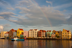 At the end of the rainbow (clee130) Tags: ocean travel blue sunset sea sky sun travelling water netherlands colors set clouds lens geotagged lumix boat rainbow colorful ant panasonic curacao 17 caribbean pancake 20mm curaçao willemstad handelskade dmc antilles netherlandsantilles f17 m43 gf1 mft micro43 microfourthirds dmcgf1 panasonicdmcgf1