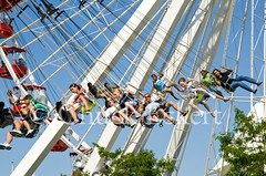 Around the World 5 (Chuck Eckert / Chicago & Beyond) Tags: park travel family usa chicago tourism smiling kids laughing children fun amusement illinois ride chairs spin group free riding amusementpark navypier leisure recreation suspended dizzy excitement aroundtheworld whirl windycity youthculture disorienting sightsee