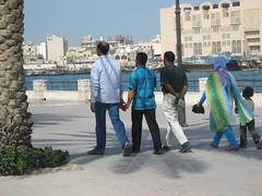 Men holding hands (Sakena) Tags: men uae handholding canonixus50