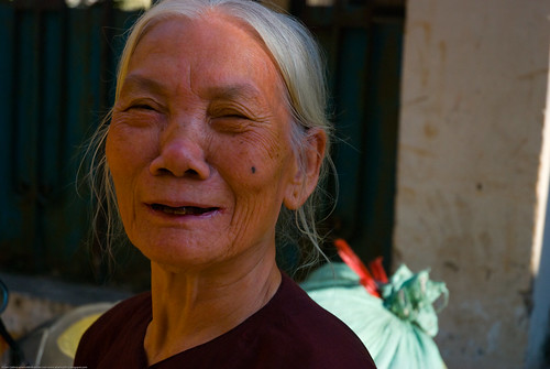 Old lady smiling in Hanoi, Vietnam