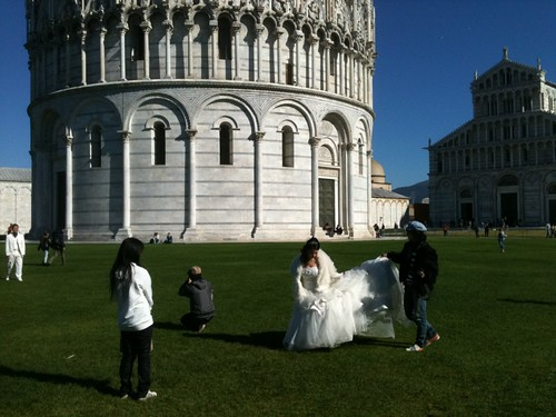 Japanese bridal party before the tower in Pisa