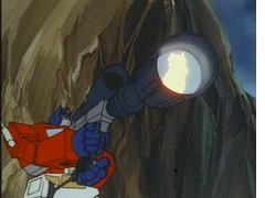 Optimus Prime firing Megatron