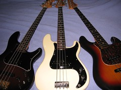 three basses and one boy