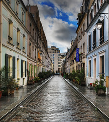 The Hotel of Cremieux Street (David Giral | davidgiralphoto.com) Tags: street blue houses paris france wet rain hotel nikon searchthebest pavement after d200 coloured streeet nikond200 18200mmf3556gvr copyrightdgiral davidgiral