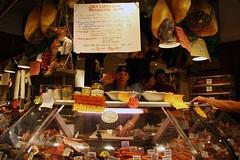 Vancouver | The meat man waves (ardenstreet) Tags: canada vancouver happy bc counter stranger meat friendly hi waving pate granvilleislandpublicmarket