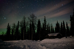 northern lights (neatmummy) Tags: winter snow cold night finland dark circle stars star woods artistic cottage trails arctic explore aurora shooting northernlights lappi explored kittila golddragon mywinners goldstaraward