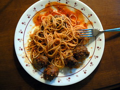 spaghetti and meatballs with plate and fork