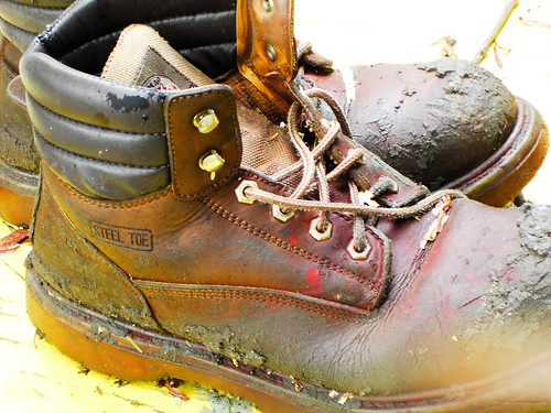 old brown work boots muddy steeltoe
