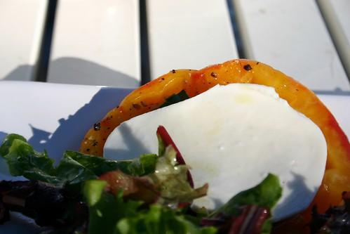 heirloom tomatoes with mozzarella & basil underneath