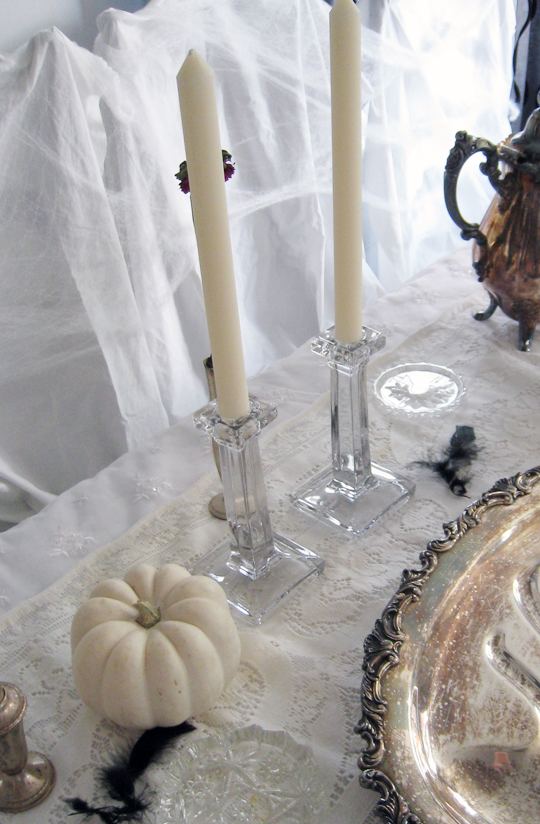 haunted tabletop halloween decor+white pumpkins+candlesticks+cobwebs+black feathers+tarnished silver+dark