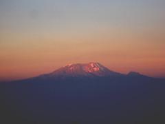 Sunset over Kilimanjaro (Mount Meru trek, Day 2) (tik_tok) Tags: africa travel sunset sun mountain kilimanjaro digital canon landscape geotagged tanzania volcano a520 peak hike powershot climbing arusha 2007 canonpowershot meru mountmeru